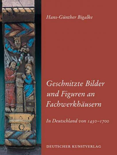 Geschnitzte Bilder und Figuren an Fachwerkhäusern.