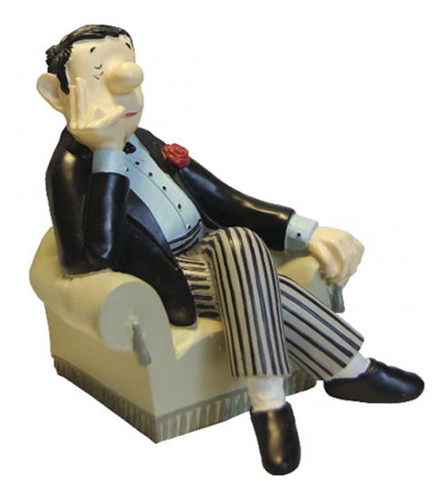 Loriot im Sessel. Buchstütze.