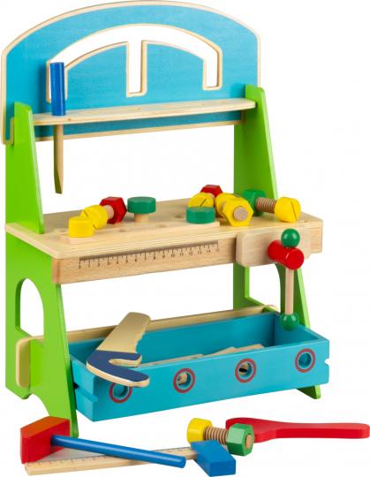 Werkbank mit Werkzeugen. Farbiges Holzspielzeug.